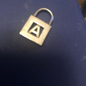 "Tiffany & Co. ""A"" Lock necklace pendant"